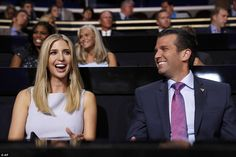 Ivanka Trump smiles as she watches speeches at the Republican National Convention alongside brother Donald Jr