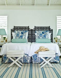 love the chinoiserie headboards... great twin bed combo for boy/girl twins bc the color scheme is neither too masculine nor feminine.  the rug makes the look a bit beachy, so i'd switch that to a silk/wool et voila all good.  i might also do the headboards in red.