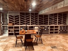 Custom wine room w barrel stave ceiling, tile floor, climate control, glass door, and led package Just Wine, Daniel Island, Climate Control, Wine Collection, Wine Storage, Wine Cellar, Glass Door, Storage Solutions, Wine Rack