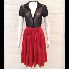 Red Vintage skirt True vintage, tiered cotton, full skirt. This adorable, feminine skirt hits right below the knee and has a size zip and hook and eye closure. The wait measures 25in and the shirt is 26in top to bottom. It will fit a 2/4 best. Vintage Skirts A-Line or Full