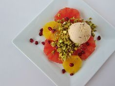 Citrus Carpaccio with Grapefruit Lavender Ice Cream, Pistachio Crumble, and Lavender Syrup at Fragrant Vanilla Cake