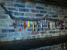 Dads old fishing lures make a great mantel piece.