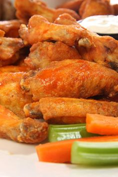 Crock Pot Chicken Wings...the combination of lemon juice, chili sauce, molasses & more, makes this sauce so flavorful!  Serve with your favorite dipping sauces!