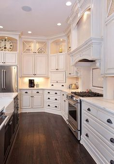 White cabinets with dark floors and dark hardware.