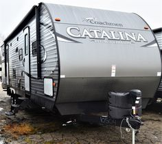 """FAMILY FUN IS GUARANTEED IN THIS BUNKHOUSE!   2017 Coachmen Catalina Legacy Edition 323BHDS CK  Come home to this luxurious 35' 10"""" long bunkhouse travel trailer and enjoy all the comforts of home (and then some!). Your family will love the large rear bunkhouse, full-sized exterior camp kitchen, and huge patio awning for shade. Has a dry weight of 7,750 lbs.  Give our Catalina Legacy Edition expert Karin Florida a call 810-834-9851 for info. Bunkhouse Travel Trailer, Coachmen Rv, Rv Dealers, Rvs For Sale, Michigan, Camper, Florida, Exterior, Patio"""