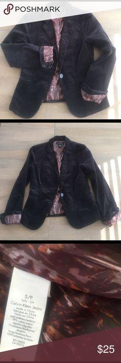 CK deep olive corduroy blazer CK cotton corduroy blazer. 99/1 cotton /spandex. Machine washable. 2 buttons on cuff make it easy to roll & expose lining on cuffs. Color is very dark green/grey Calvin Klein Jeans Jackets & Coats Blazers