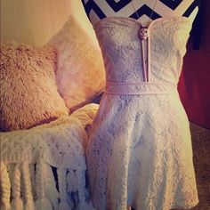 Strapless Cream & Pink Lace Dress Cream and light pink lace. With pockets and a side zipper to get on and off. Has Scrunchy back on top for a more perfect fit. So cute and comfy. From urban outfitters.  Never been warn. Love this but will never wear! Fun for a wedding or just hanging at the beach.  Had this up for a couple years, cannot believe this hasn't been sold. I think it's beautiful. Always open to offers!  Urban Outfitters Dresses