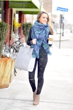 Shop this look on Lookastic:  http://lookastic.com/women/looks/scarf-skinny-jeans-ankle-boots-watch-tote-bag-crew-neck-sweater/9113  — Navy and Green Plaid Scarf  — Black Ripped Skinny Jeans  — Tan Suede Ankle Boots  — Black Ceramic Watch  — Light Blue Leather Tote Bag  — Black Crew-neck Sweater
