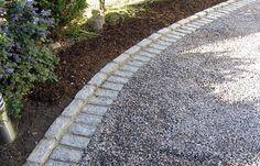 stone edging + gravel.--tehdään hyvin,pääsee helpommalla