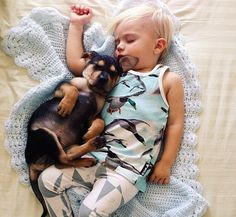 OMG ♥ this kid only sleeps with his dog... There are a LOT of pics like this :) - Momma's Gone City