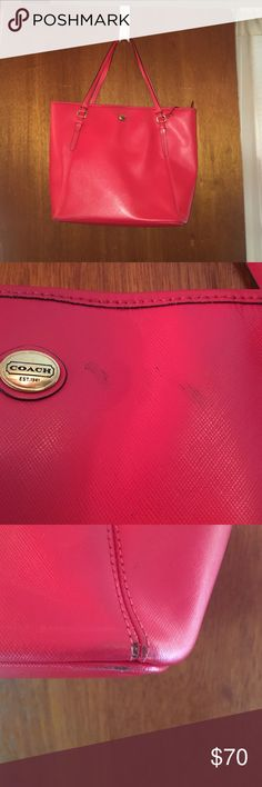 Coral / red coach purse Coral / red Coach purse. A little worn (shown in pictures. But overall good condition. Great bag to use for going out and/ or school. Dimensions are about 15 inches across and 11.5 inches deep. Inside contains a zip pocket, a phone pocket and another small pocket, all along the walls of the bag. Coach Bags Totes