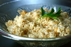 Garlic Rice Pilaf--2 tbsp. butter 3 cloves garlic, minced or pressed 1 cup long-grain white rice 2½ cups chicken broth, divided ½ tsp. salt ½ tsp. pepper Squee...