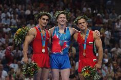 The three medallists in the men's floor routine at the 2004 Summer Olympic Games in Athens on Sunday August 22, 2004: Canada's Kyle Shewfelt (gold), Romania's Marian Dragulescu (silver) and Bulgaria's Jordan Jovtchev (bronze). (CP PHOTO 2004/Andre Forget/COC)