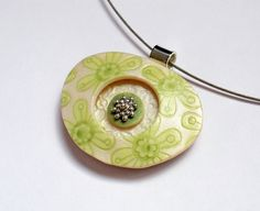 Green floral print on pearl polymer clay by Orly Fuchs Gal-chen, via Flickr