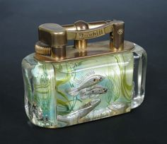 A Dunhill Aquarium table lighter. The side panels of the lighter are made of Perspex (a material similar to Lucite).