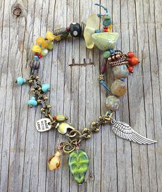 "MarketPlace Bracelet ""Green Speckled Bird"" by Toni McCarthy"