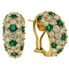 Emerald and yellow gold hoops by Tiffany!