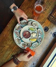 It's always time for buck-a-shuck on my watch.  We visit @localsonlytoronto way too often to take up their 5-8PM deal (half-price wine too).  ...I think we need some time apart.   Share your oysters spot (even better if it's $1)   Sporting the bondi white @danielwellington strap. The holiday deals are out get double the savings with my code: meetandeats15  #danielwellington #dwforeveryone [#ad]