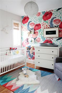 Baby girl's nursery with accents in floral and geometrics.