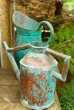 Wonderful patina on this old watering can and pitcher.