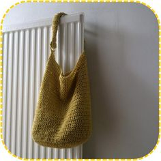 The perfectly slouchy bag!  Crocheted with a hook size 5mm. very simple pattern.