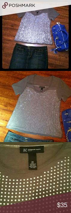 Sparkling top Fun sparklie top from INC International Concepts in size 0X.    Silver metal sparkling beads attached to front of sheer grey shirt that is 100 % rayon, material drapes beautifully.  Back is solid grey This top is fun and sexy, it can be worn casual with jeans or classy with a little black skirt Only worn once,  perfect condition Pictures just do not do this top justice! !  Sparkle and shine! INC International Concepts Tops