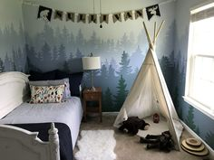 Little boys bedroom with hand painted mountain mural Mountain mural toddler bedroom. Little boys bedroom with hand painted mountain mural