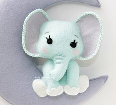 Elephant mobile on the Moon ideal for decorating a nursery Items are made of felt Ribbon to hang the decoration on the wall or ceiling. Hand sewn Due to sensitivity of the material, it is not recommended to wash. This decoration is intended for babys room decor. It can not be used as a