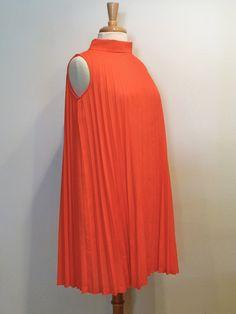 nicole 1960s Dress / Coral Pleated Swing Dress. $58.00, via Etsy.