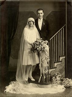 '20s wedding photo. Love the cloche hat and veil!-Pinned because everything looks so much like Nonie's!