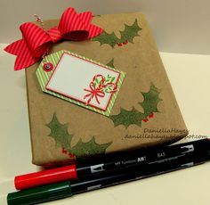 Making pretty packages is super easy and you don't need a lot of supplies! Make your own Christmas Gift Wrapping with Tombow Dual Brush pens and wrap with our Adhesive tape runners! This project was made by Tombow Design Team member Christmas Gift Wrapping, Christmas Tag, Tombow Dual Brush Pen, Team Member, Holiday Crafts, Make Your Own, Pens, Runners, Super Easy