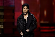 Prince Photos Photos - Musician Prince speaks onstage at the 55th Annual GRAMMY Awards at Staples Center on February 10, 2013 in Los Angeles, California. - The 55th Annual GRAMMY Awards - Show