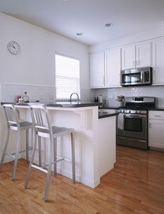 The stools, white cabinets, and hardware-perfect