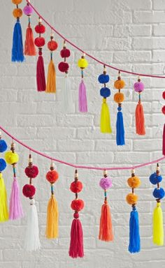 This colorful hanging garland is like a party for your décor. It's adorned with playful tassels, pom poms and wooden beads for a truly festive look. Hanging Garland, Pom Pom Garland, Tassel Garland, Garlands, Ganesh Chaturthi Decoration, Arabian Party, Decoration For Ganpati, Henna Party, Birthday Diy