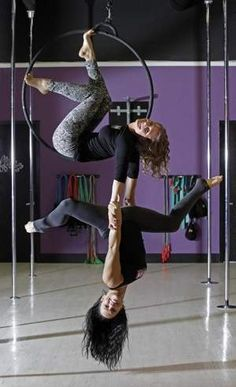 Fitness takes flight in aerial classes Students twirl though the air from silks and hoops http://www.press-citizen.com/article/D2/20130415/LIFE/304150022/Fitness-takes-flight-aerial-classes