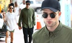 Robert Pattinson and FKA Twigs don buttoned up shirts and work boots