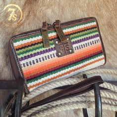 The Higgins Clutch! Everything you'll need in a wallet/clutch for spring! #serape #springstyle #savannah7s #savannahsevens