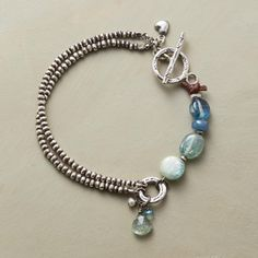 "TIDEPOOL BRACELET -- As the surf retreats, small treasures abound—kyanite, apatite and aquamarine, surrounded by Thai silver beads and clasped with a Thai silver toggle. Exclusive. 7-1/2""L."