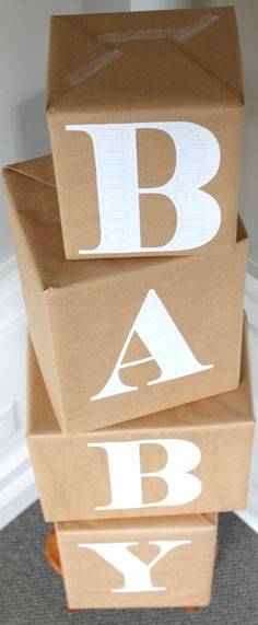 Diaper Box Baby Blocks ~ Made out of diaper boxes wrapped in brown paper to resemble baby blocks... Really cute baby shower idea