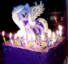 Princess Luna My Little Pony Teen Birthday Cake Made for my daughter who's 14:) Basic double cake in 8x8 pan 2 devils food cake mixes purple Vanilla Icing with confetti and toy Luna on top