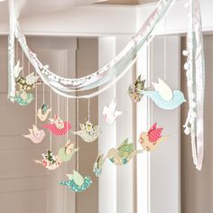 Beautiful DIY Bird Banner. Home Decor or party decor perfect for spring. Enter Code 1215-VTO to snag this Flock Together craft kit. Kits are only available while supplies last so don't miss out!