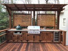 East Cobb Outdoor Dream Kitchen During the century, cooking outdoors was typically a summer novelty, wearing off as soon as the leaves started to shimmy in the cool fall breeze. Big Green Egg Outdoor Kitchen, Outdoor Kitchen Grill, Outdoor Grill Area, Outdoor Grill Station, Outdoor Cooking Area, Backyard Kitchen, Summer Kitchen, Outdoor Kitchen Design, Outdoor Grilling