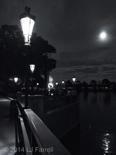 Full moon over lagoon and World Showcase at Epcot