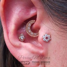 "Gloria came by yesterday for some serious ear upgrading. In her daith piercing, a rose gold and diamond ""Inara"" by @bvla. In her conch is a gold snowflake by @leroifinejewelry, previously installed by me. In her new tragus piercing, a Rose gold and diamond"