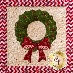 This wreath is one of nine blocks in Shabby Fabrics' Christmas Keepsakes wall hanging. All of the blocks feature appliqued Christmas motifs in traditional colors. See all nine blocks here: https://www.shabbyfabrics.com/-Christmas-Keepsakes-BOM-Pre-fusedLaser-P30953.aspx