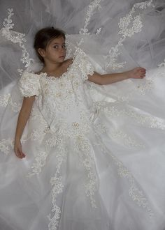 Capture your little girl in her mom's wedding dress, then share it on her big day!
