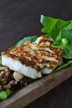 skillet fried(or grilled) halloumi cheese served with fresh arugula, cranberry quinoa and rice mixture, edamame, garbanzo been sand avocado drizzled with a cranberry vinaigrette Halloumi Salad, Grilled Halloumi, Greek Recipes, Wine Recipes, Salad Recipes, Halloumi Cheese Recipes, Cranberry Vinaigrette, My Favorite Food, Favorite Recipes