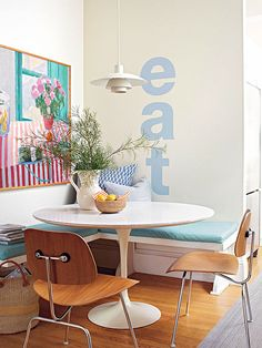 This sweet breakfast nook fits perfectly into a previously unused corner of the kitchen. A built-in bench wraps the corner, adds storage, and lots of seating. Vintage inspired furniture and light fixtures add a playful, casual vibe to the eating area.