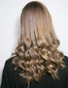 Smooth up top, loose spiral curls at bottom.