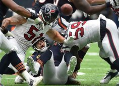 Houston Texans outside linebacker Whitney Mercilus (59) forces Chicago Bears quarterback Jay Cutler, center, to fumble during the second half of an NFL football game Sunday, Sept. 11, 2016, in Houston.